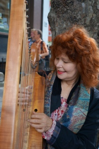 harpist playing the pachelbel on Dame Stteet for change