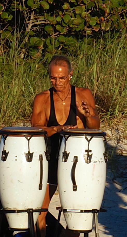 a dancing, blessing, drummer