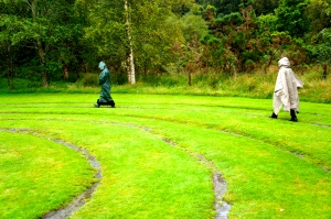 Mary and Patricia walking the Glendalough labyrinth in the rain