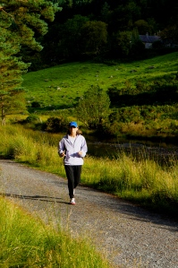 Patricia running along the Glendsan in Glendalogh