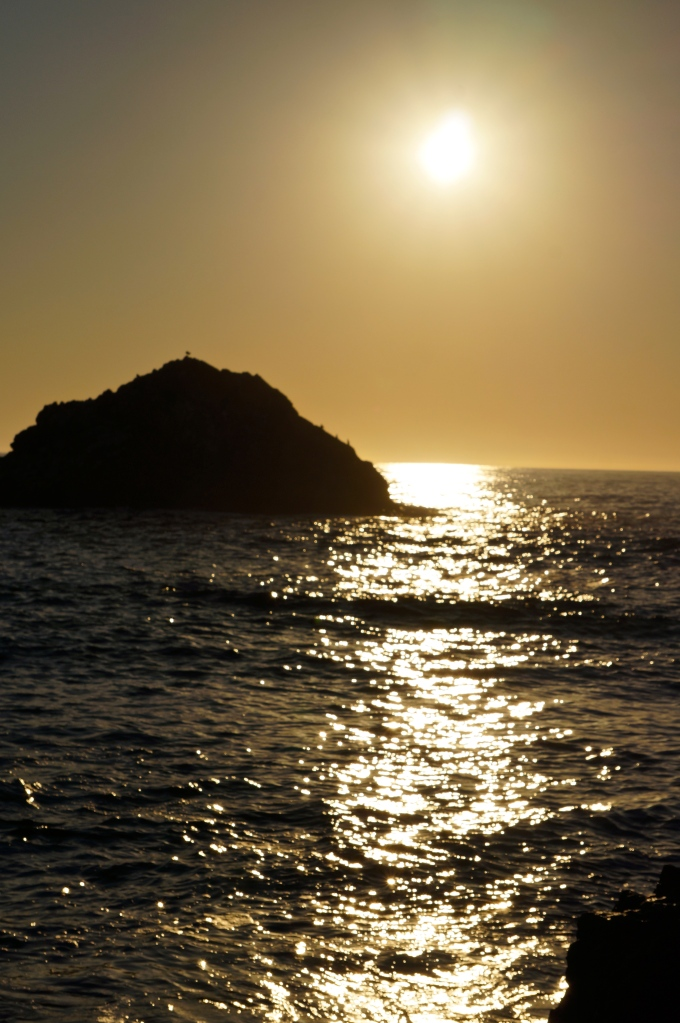 sun water and rock at day's end