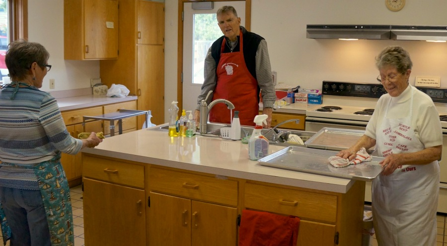 Sharon, Dick & Jean - cleaning up at the end of day three of peanut brittling at Trinity Church of the UCC - 12