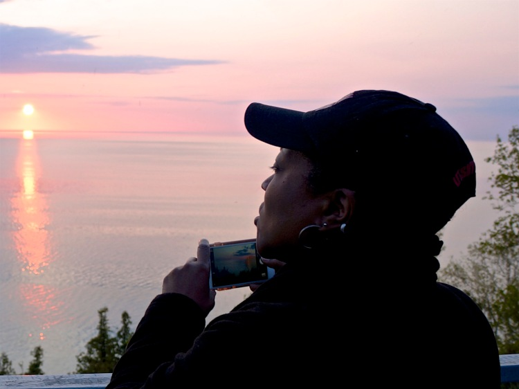 Karen Georgia Thompson capturing the Leelanau sunset on her iPhone and in her soul - May 21, 2016